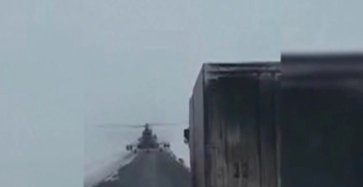 Kazakhstan: Military helicopter stops on highway to ask trucker for directions