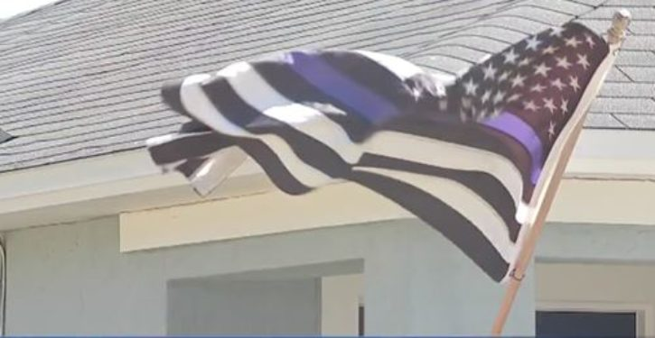 Florida homeowner told to take down 'racist, offensive' flag; so, what was its message?