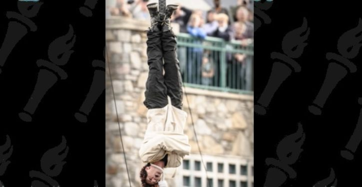 Illusionist Criss Angel rushed to hospital after upside-down strait jacket trick goes horribly wrong