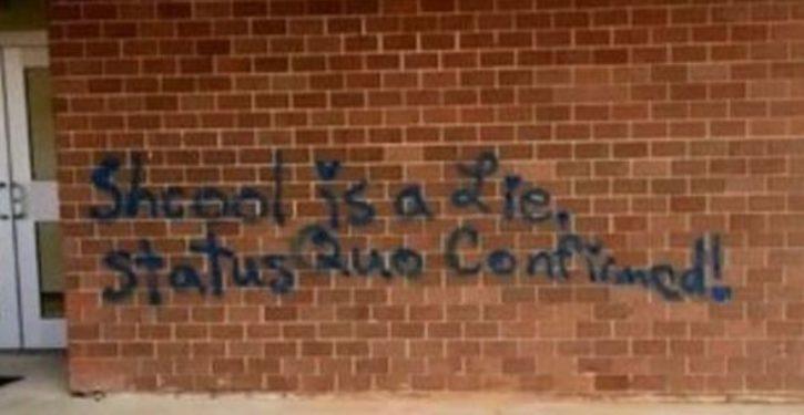Graffiti on school blasts educational system, but it seems spelling wasn't culprit's strong suit
