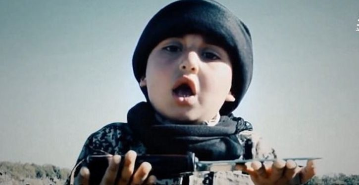 6-year-old assists ISIS killer behead a prisoner in horrifying new footage
