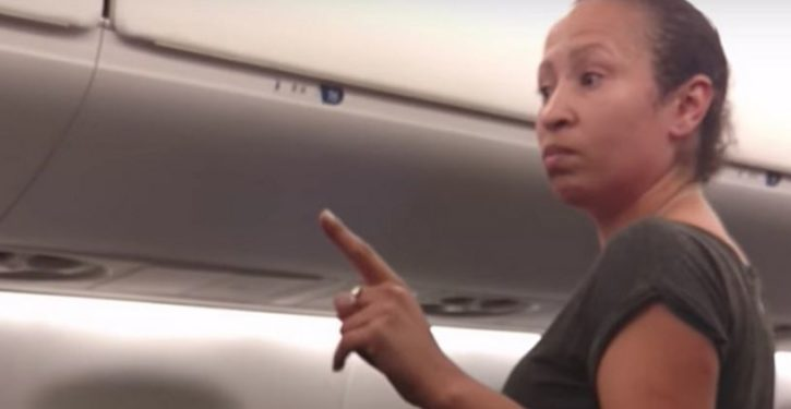 Foul-mouthed woman loses it when flight is delayed