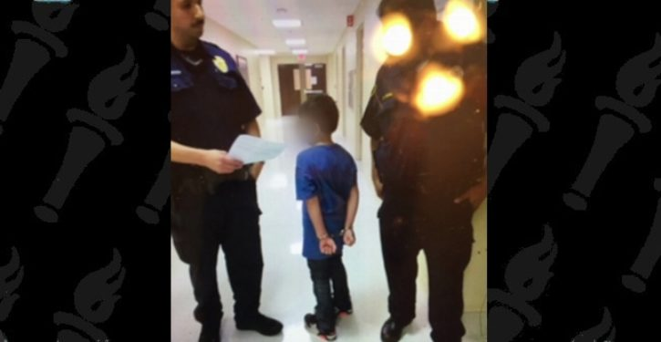 This photo of 7-year-old in handcuffs causes online outrage
