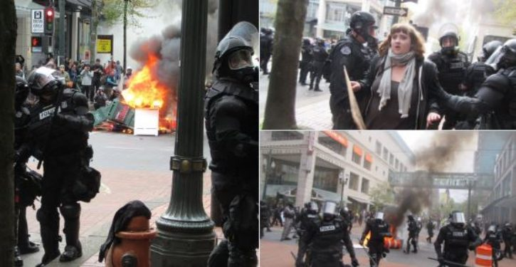 Portland May Day protesters hurl full cans of Pepsi at police