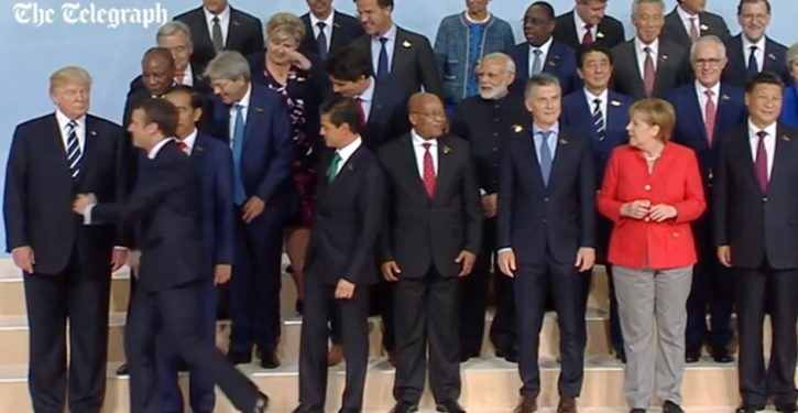 In weird move, France's Macron jostles G20 VIPs in group photo to get next to Trump