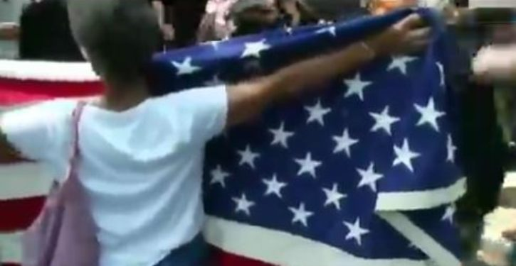 Watch: Older woman holding American flag hit, dragged in Boston