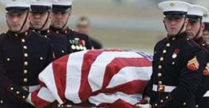 Woman told not to sing national anthem on flight carrying remains of fallen Green Beret