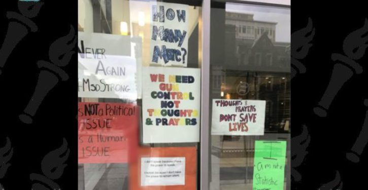 In display of signs used in 'March for Our Lives,' D.C. church denounces prayer