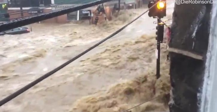 Epic flash flood devastates Baltimore suburb; buildings toppled, torrents raging through streets