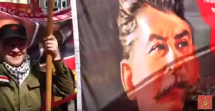Stalin banner, lit flares enliven May Day march in London