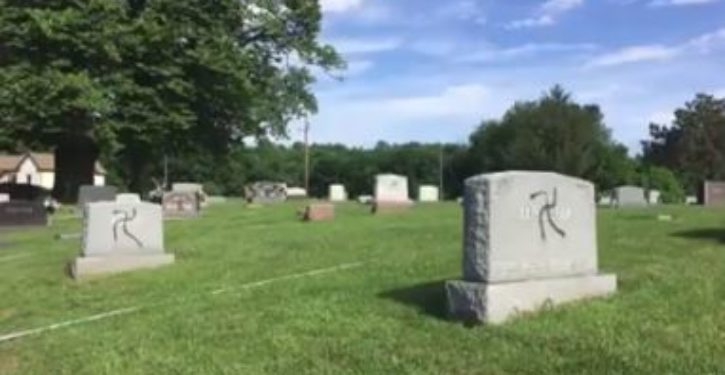 On Memorial Day weekend, veteran's cemetery desecrated with swastikas