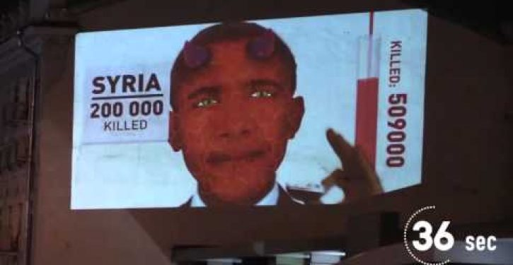 Video in Moscow shows Obama as devil devouring foreign peoples