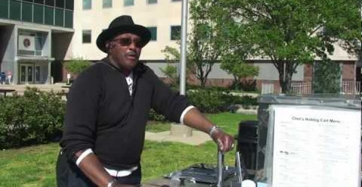 Union protesters trash iconic MI hot dog cart, call black owner N-word