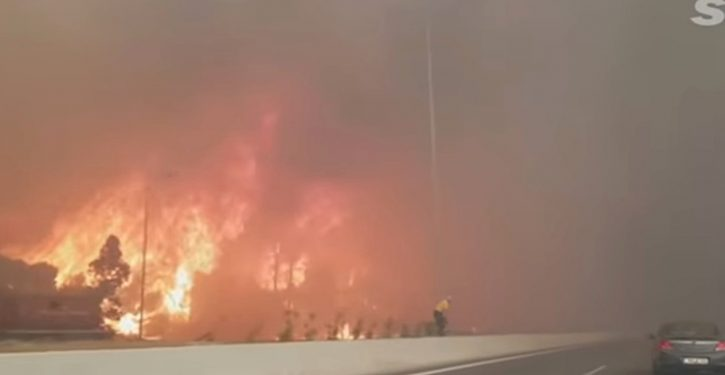 Father and son drive through flames in bid to escape Montana forest fire