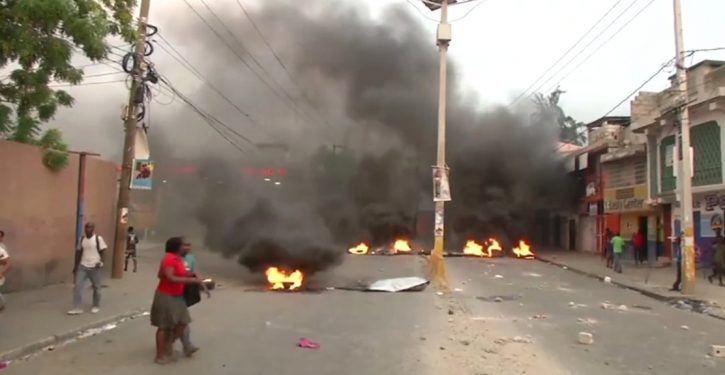 Haiti in flames as protests over gas-price hikes spread; U.S. cancels all airline flights