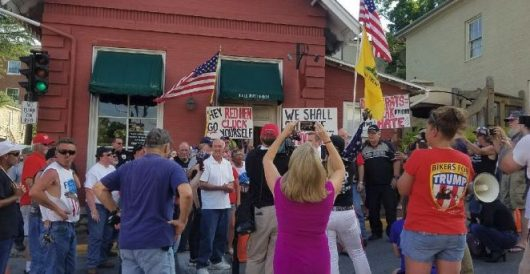 Reopening of Red Hen restaurant greeted by 'Cluck you!' protest by Thomas Madison
