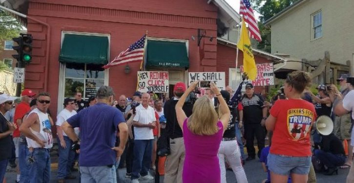 Reopening of Red Hen restaurant greeted by 'Cluck you!' protest