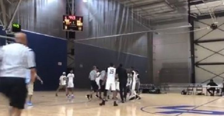 Refs and basketball players square off in wild brawl