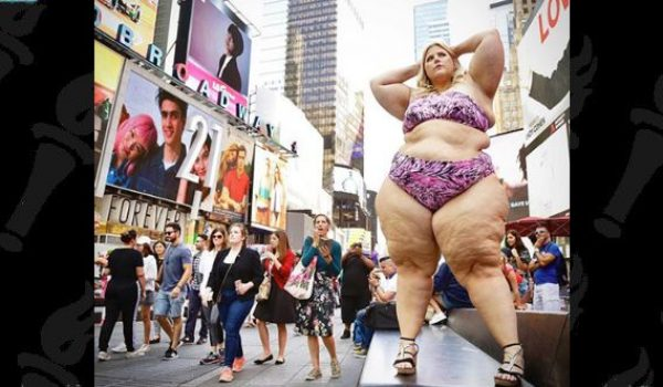 What happens when a fat (er, big boned) women poses in a teeny-weeny bikini in Times Square? by LU Staff