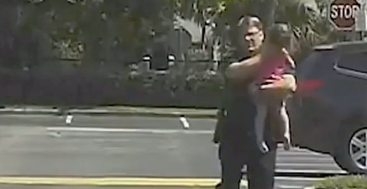 Dramatic video shows moment Florida cop saves little girl trapped in hot car for 12 hours