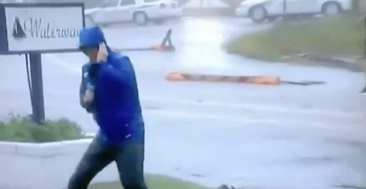 And the Oscar goes to … Weather Channel guy hamming it up to show how fierce winds are