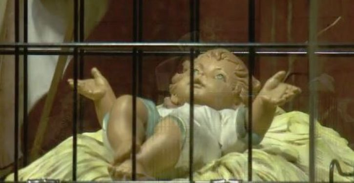 To demonstrate solidarity with illegal aliens, church nativity features baby Jesus in a cage