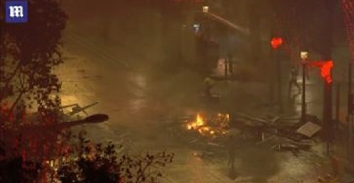 Paris rioters steal police assault rifle, torch dozens of cars, vow to 'stay in the streets'