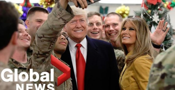 Troops Trump visited asked him to sign MAGA hats, which may violate military rule