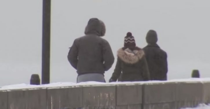 In frigid Chicago, people are being robbed of their coats at gunpoint