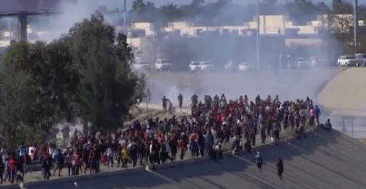 Border Patrol fires tear gas after caravan migrants rush U.S. border, throw rocks, on New Year's Eve