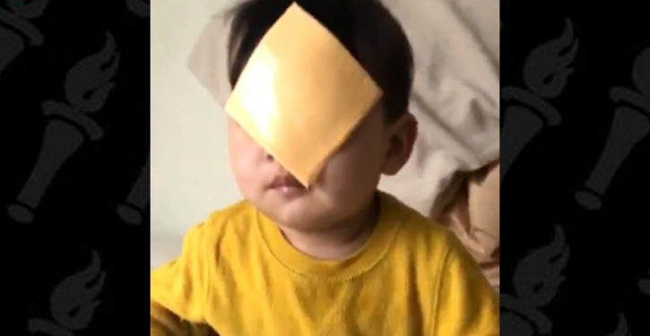 Why people are throwing cheese at babies