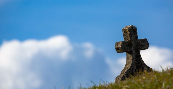 Crosses on grave in Italian cemetery covered to avoid offense to 'other religions'