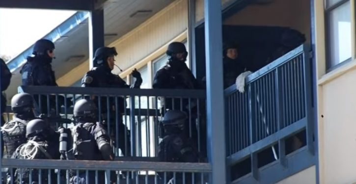SWAT team destroyed woman's house chasing fugitive. City refuses to pay for damages