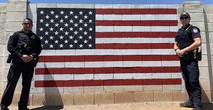 Phoenix police officers repaint vandalized American flag mural