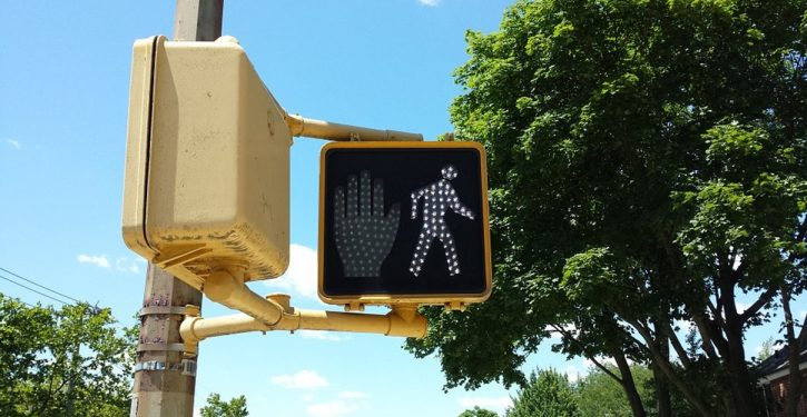 College students sign petition to ban offensive 'white man' walk signals at crosswalks
