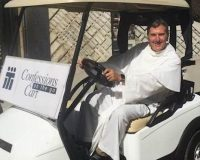 Campus priest on golf cart offers unique service