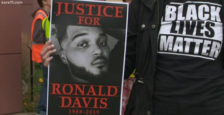 Black man rear-ends police car, charges cop with knife, is shot dead, community protests