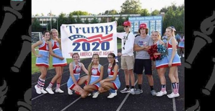 HS cheerleaders on probation after posing with Trump sign. Meanwhile, at another school…