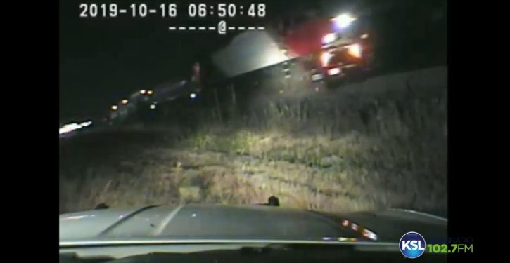 VIDEO: Cop risks life to save driver of stalled car just before train hits
