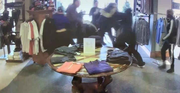 Clothing store employees battle shoplifters trying to steal Canada Goose jackets