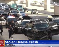 Stolen hearse crashed on L.A. freeway in police chase; casket, body inside