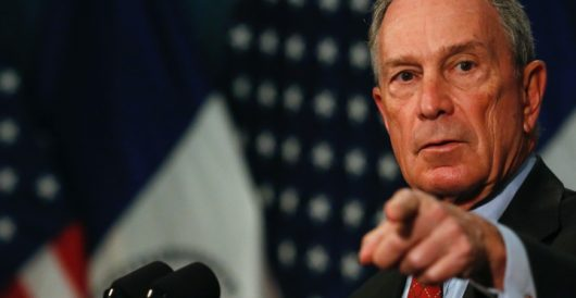 Watch Bloomberg lick his fingers, then handle food at campaign headquarters by LU Staff