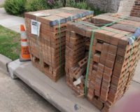 People want to know who's delivering pallets of bricks to protest sites across the U.S.