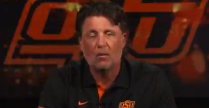 OK State Coach Gundy takes a knee or two