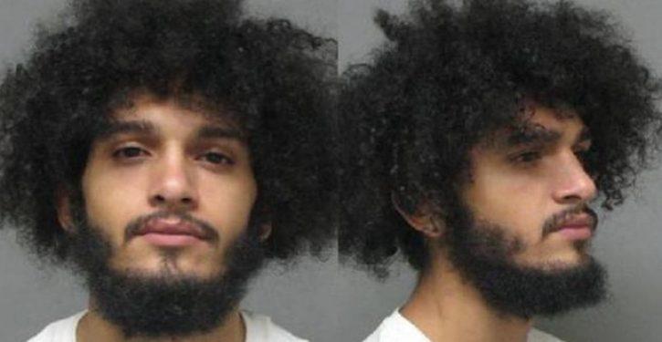 Man arrested after photo of him kneeling on white toddler's neck goes viral