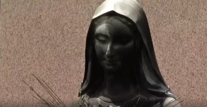 Statue of Virgin Mary set on fire outside Boston church