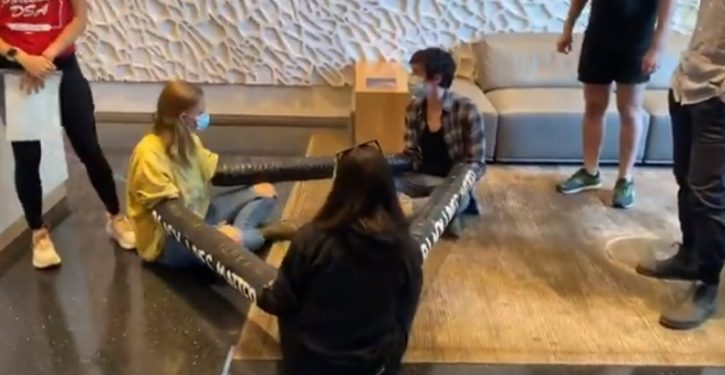 'Protesters' chain themselves in lobby of Portland mayor's condo building, chant and dance in street