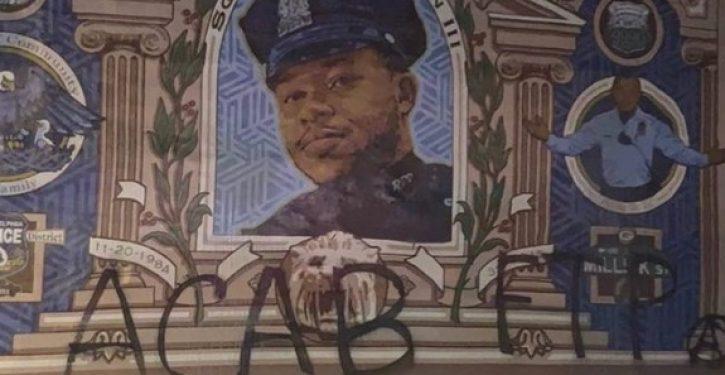 Anti-police graffiti spray-painted on mural of slain Philadelphia police officer