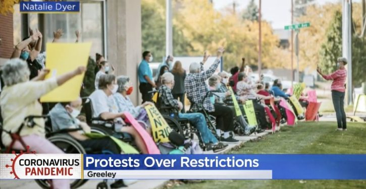 Nursing home residents, many in wheelchairs, stage protest of virus restrictions