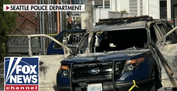 Man arrested in Seattle for torching police car … with officer still inside!